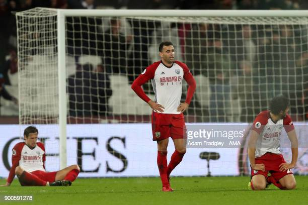 A dejected Hal RobsonKanu Grzegorz Krychowiak and Ahmed Hegazi of West Bromwich Albion after conceding a last minute goal iduring the Premier League...