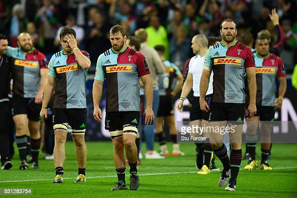 Dejected Harlequins players walk off the pitch following their team's 2619 defeat during the European Rugby Challenge Cup Final match between...