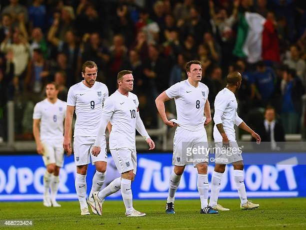 Dejected Harry Kane Phil Jones Wayne Rooney and Fabian Delph of England look on after conceding the first goal during the international friendly...