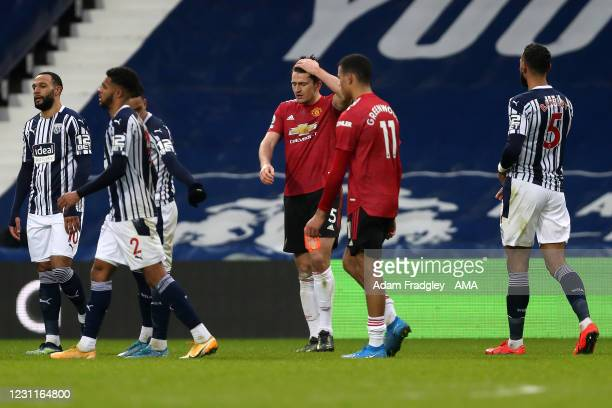 Dejected Harry Maguire of Manchester United reacts at the final whistle during the Premier League match between West Bromwich Albion and Manchester...