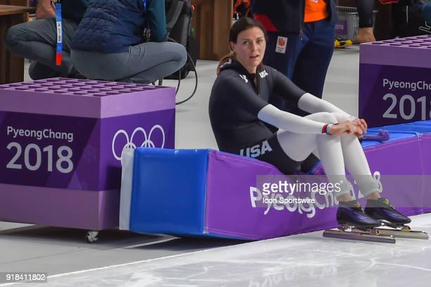 A dejected Heather Bergsma recovers on a barrier following her 8th place finish in the 1000M Ladies Final during the 2018 Winter Olympic Games at...
