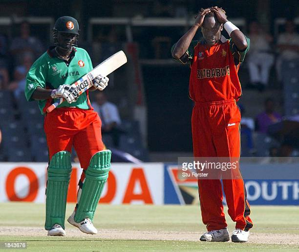 Dejected Henry Olonga of Zimbabwe holds his head during the Super Six match between Kenya and Zimbabwe at Goodyear Park in Bloemfontain, South Africa...