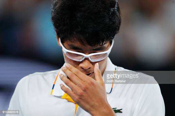 A dejected Hyeon Chung of South Korea reacts after retiring injured due to a blistered foot in his semifinal match against Roger Federer of...