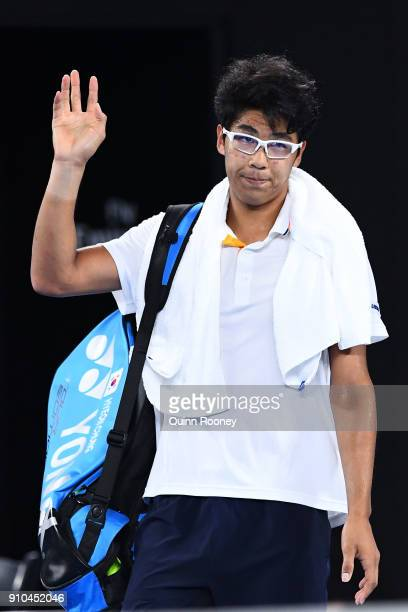 A dejected Hyeon Chung of South Korea waves to the crowd after retiring hurt in his semifinal match against Roger Federer of Switzerland on day 12 of...