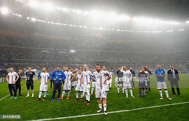 Dejected Iceland supporters applaud their supporters after the UEFA EURO 2016 quarter final match between France and Iceland at Stade de France on...