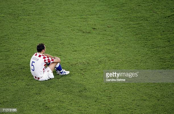 A dejected Igor Tudor of Croatia sits on the pitch following his team's 22 draw and exit from the competition during the FIFA World Cup Germany 2006...