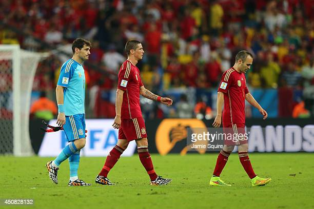 A dejected Iker Casillas Fernando Torres and Andres Iniesta of Spain looks on after being defeated by Chile 20 during the 2014 FIFA World Cup Brazil...