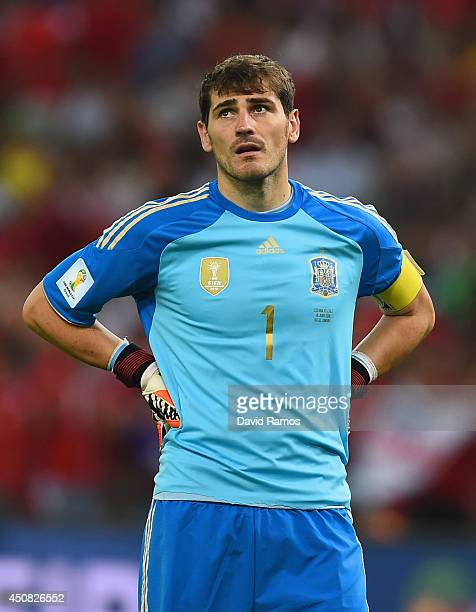 A dejected Iker Casillas of Spain looks on during the 2014 FIFA World Cup Brazil Group B match between Spain and Chile at Maracana on June 18 2014 in...