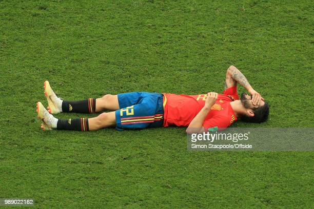 A dejected Isco of Spain lies prone on the pitch after Spain are knocked out of the tournament on penalties during the 2018 FIFA World Cup Russia...