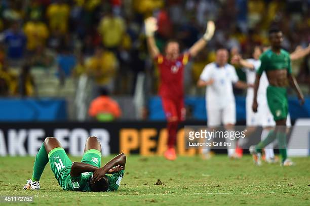 A dejected Ismael Diomande of the Ivory Coast lies on the field after being defeated by Greece 21 during the 2014 FIFA World Cup Brazil Group C match...