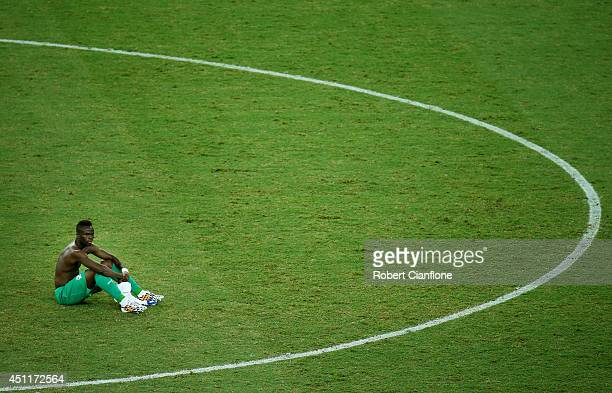 A dejected Ismael Diomande of the Ivory Coast looks on after being defeated by Greece 21 during the 2014 FIFA World Cup Brazil Group C match between...