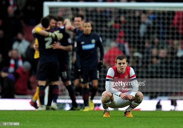 A dejected Jack Wilshere of Arsenal reacts following his team's 10 defeat during the FA Cup with Budweiser fifth round match between Arsenal and...