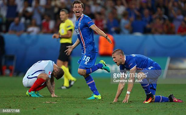 A dejected Jack Wilshere of England as Elmar Bjarnason of Iceland runs off to celebrate after the UEFA EURO 2016 Round of 16 match between England...