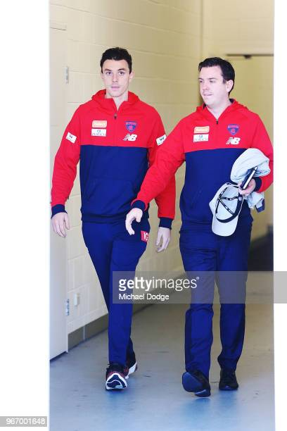 A dejected Jake Lever of the Demons walks out with media manager Matt Goodrope to face a media conference during a Melbourne Demons AFL training...