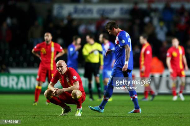 A dejected James Collins of Wales looks on folowing his team's 21 defeat during the FIFA 2014 World Cup qualifier between Wales and Croatia at The...