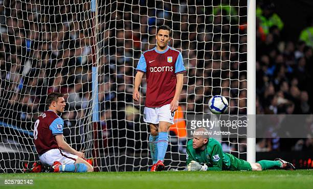 A dejected James Milner Stuart Downing and goalkeeper Brad Friedel of Aston Villa after Tim Cahill of Everton scored to make it 12