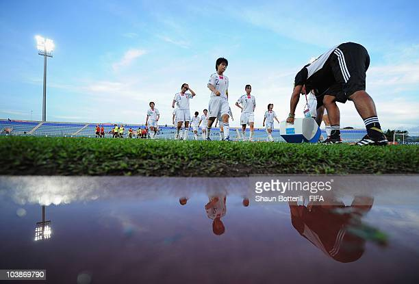 A dejected Japan leave the field after losing the FIFA U17 Women's World Cup Group C match between Spain and Japan at the Ato Boldon Stadium on...