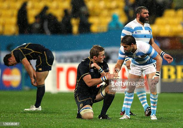 A dejected John Barclay of Scotland shakes hands with Horacio Agulla of Argentina following his team's 1312 defeat during the IRB 2011 Rugby World...