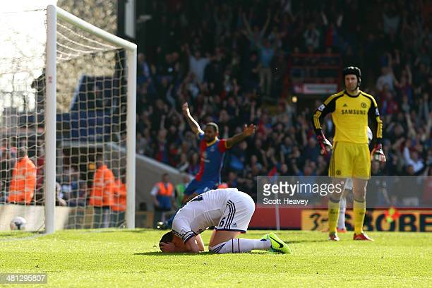 A dejected John Terry of Chelsea reacts after opening the scoring with an own goal during the Barclays Premier League match between Crystal Palace...