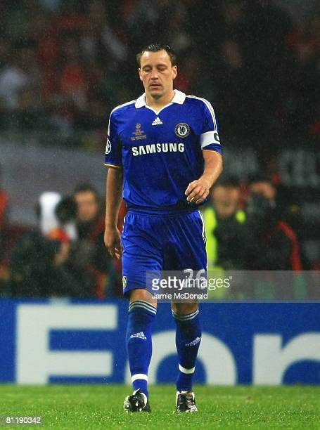 Dejected John Terry of Chelsea walks back to his teammates after missing a penalty during the UEFA Champions League Final match between Manchester...