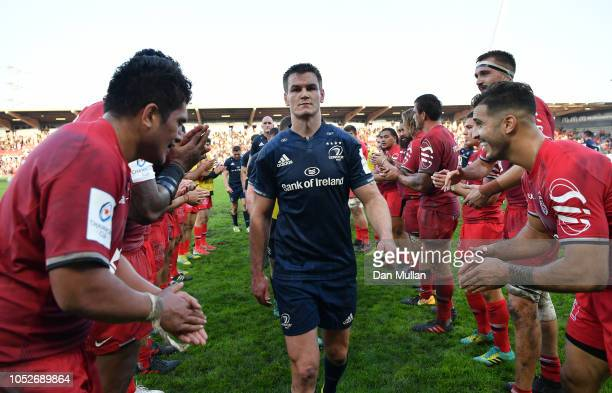 A dejected Johnny Sexton of Leinster leads the team off the field following defeat during the Champions Cup match between Toulouse and Leinster Rugby...