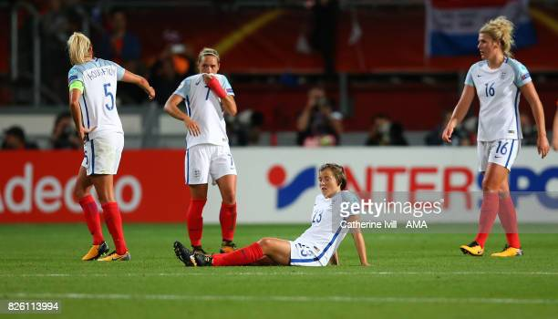 A dejected Jordan Nobbs and Fran Kirby of England Women with their team mates after the UEFA Women's Euro 2017 semi final match between Netherlands...