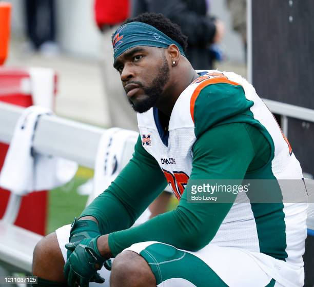A dejected Jordan Thompson of the Seattle Dragons looks on from the bench in the fourth quarter against the Houston Roughnecks during an XFL game at...