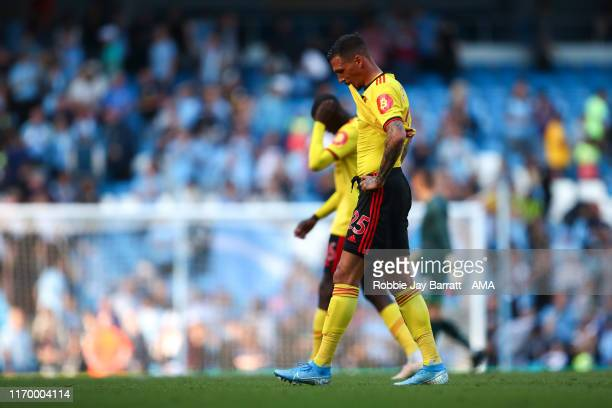 A dejected Jose Holebas of Watford walks off at full time during the Premier League match between Manchester City and Watford FC at Etihad Stadium on...