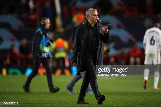 A dejected Jose Mourinho manager head coach of Manchester United sticks out his little finger as he walks off at full time during the Group H match...
