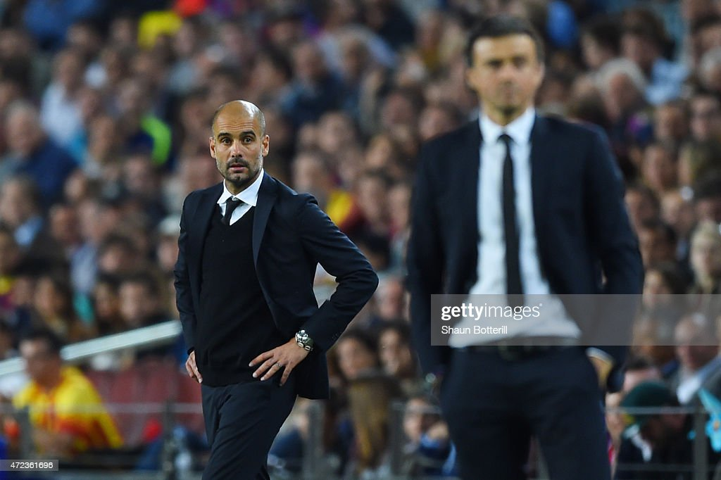 A dejected Josep Guardiola the head coach of Bayern Muenchen looks on past Luis Enrique the head coach of Barcelona during the UEFA Champions League Semi Final, first leg match between FC Barcelona and FC Bayern Muenchen at Camp Nou on May 6, 2015 in Barcelona, Spain.