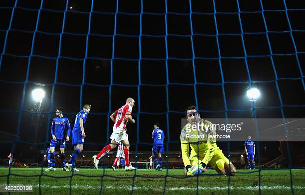 A dejected Josh Lillis of Rochdale looks on after conceding the third goal during the FA Cup fourth round match between Rochdale and Stoke City at...