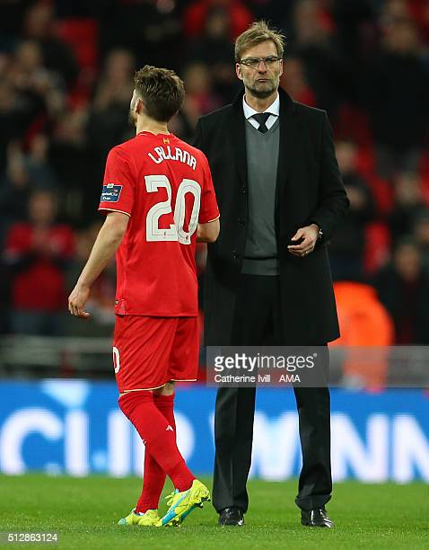 A dejected Jurgen Klopp manager of Liverpool with Adam Lallana of Liverpool after the Capital One Cup Final match between Liverpool and Manchester...