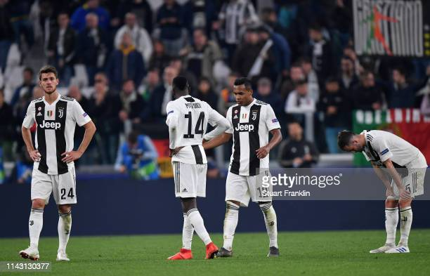 Dejected Juventus players shakes hands with each other after the UEFA Champions League Quarter Final second leg match between Juventus and Ajax at...