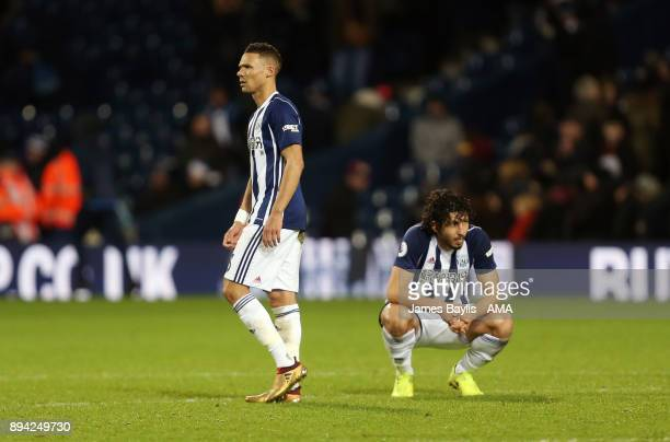 A dejected Kieran Gibbs of West Bromwich Albion and Ahmed Hegazy of West Bromwich Albion at full time during the Premier League match between West...