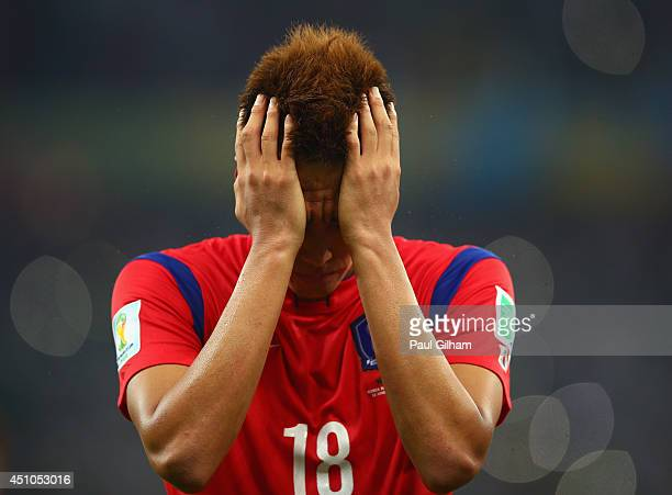 A dejected Kim ShinWook of South Korea reacts after being defeated by Algeria 42 during the 2014 FIFA World Cup Brazil Group H match between South...