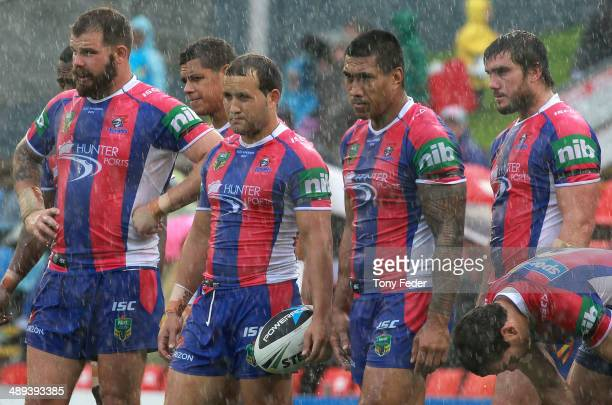 Dejected Knights players during the round nine NRL match between the Newcastle Knights and the Penrith Panthers at Hunter Stadium on May 11 2014 in...