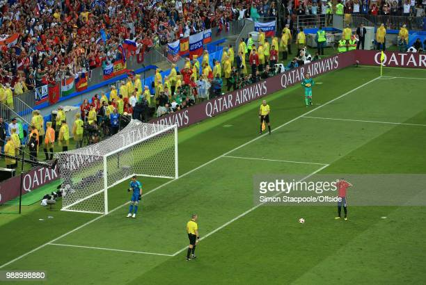 A dejected Koke of Spain hides behind his shirt after Russia goalkeeper Igor Akinfeev saves his penalty during the 2018 FIFA World Cup Russia Round...