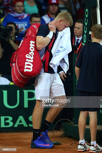 A dejected Kyle Edmund of Great Britain walks off the court following his defeat during the singles match against David Goffin of Belgium on day one...
