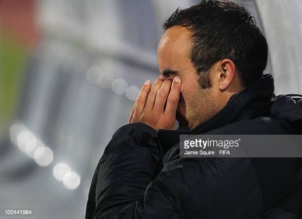 Dejected Landon Donovan of the United States sits on the bench after being knocked out of the tournament after the 2010 FIFA World Cup South Africa...