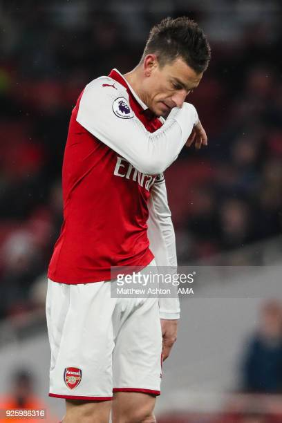 A dejected Laurent Koscielny of Arsenal reacts during the Premier League match between Arsenal and Manchester City at Emirates Stadium on March 1...
