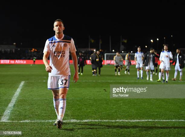 Dejected Leicester player Andy King leaves the field after the FA Cup Third Round match between Newport County and Leicester City at Rodney Parade on...
