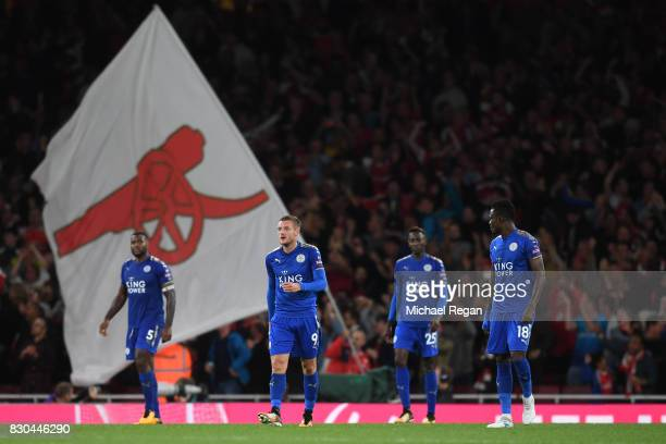Dejected Leicester players look on after conceding a fourth goal during the Premier League match between Arsenal and Leicester City at the Emirates...