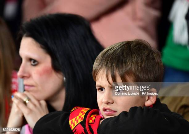 A dejected Lincoln City fan during the Emirates FA Cup quarter final at The Emirates Stadium London