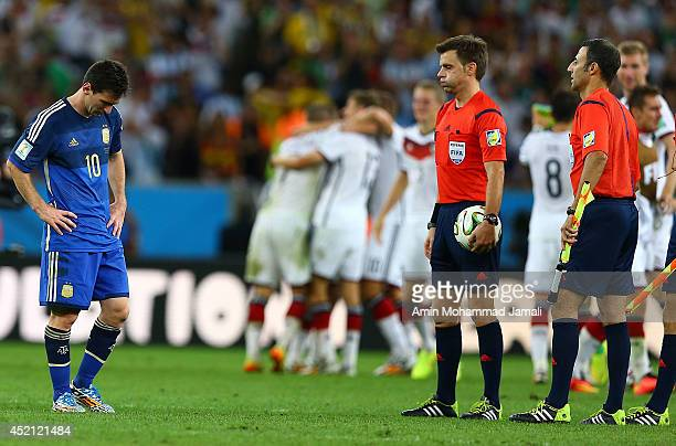 A dejected Lionel Messi of Argentina during the 2014 World Cup final match between Germany and Argentina at The Maracana Stadium on July 13 2014 in...