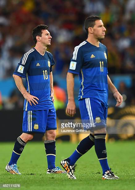 A dejected Lionel Messi of Argentina looks on after being defeated by Germany 10 in extra time during the 2014 FIFA World Cup Brazil Final match...