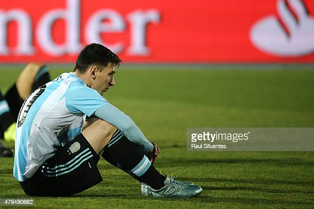 Dejected Lionel Messi of Argentina looks on after the 2015 Copa America Chile Final match between Chile and Argentina at Nacional Stadium on July 04,...