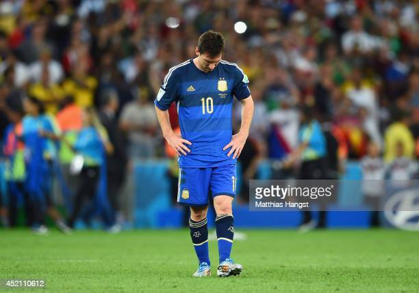 Dejected Lionel Messi of Argentina reacts after being defeated by Germany 1-0 in extra time during the 2014 FIFA World Cup Brazil Final match between...