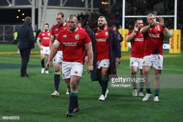 Dejected Lions players walk off the pitch following their 2322 defeat during the 2017 British Irish Lions tour match between the Highlanders and the...