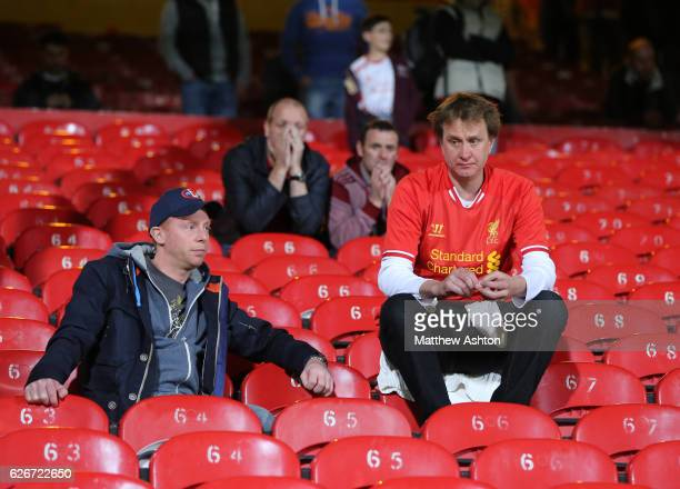 Dejected Liverpool fans sit after their team draw 33 with Crystal Palace