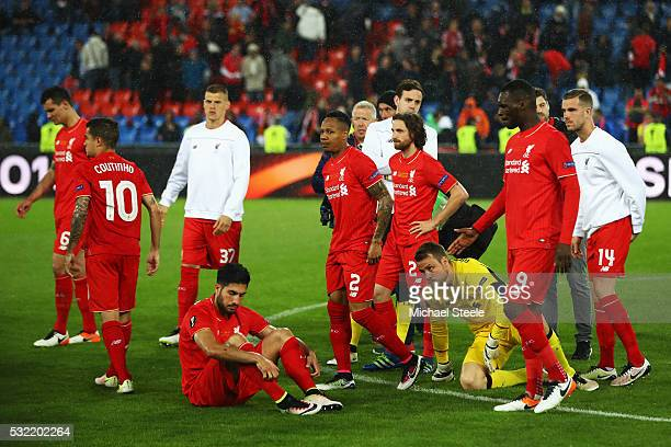 Dejected Liverpool players are seen at the award ceremoy after the UEFA Europa League Final match between Liverpool and Sevilla at St JakobPark on...